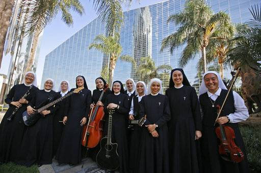 "In this Thursday, Sept. 7, 2017, photo members of ""Siervas,"" a Peruvian-based rock 'n' roll band comprised entirely of Catholic nuns rehearse a day ahead of their performance at performance at the Christ Cathedral Campus in Garden Grove, Calif. The band's name, Spanish for ""the servants,"" comes from the convent where the band was formed and still lives."