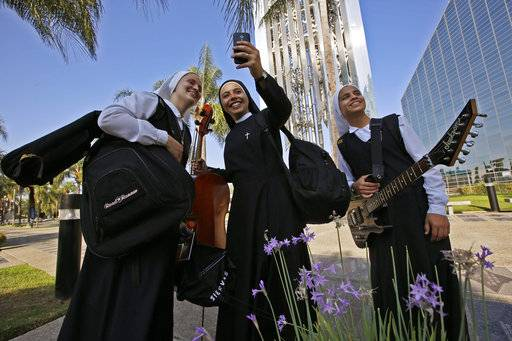 "In this Thursday, Sept. 7, 2017, photo members of ""Siervas,"" a Peruvian-based rock 'n' roll band comprised entirely of nuns rehearse a day ahead of their performance at performance at the Christ Cathedral campus in Garden Grove, Calif. Their songs of love and faith in Spanish have earned over a million YouTube views and led to the release of two CDs."