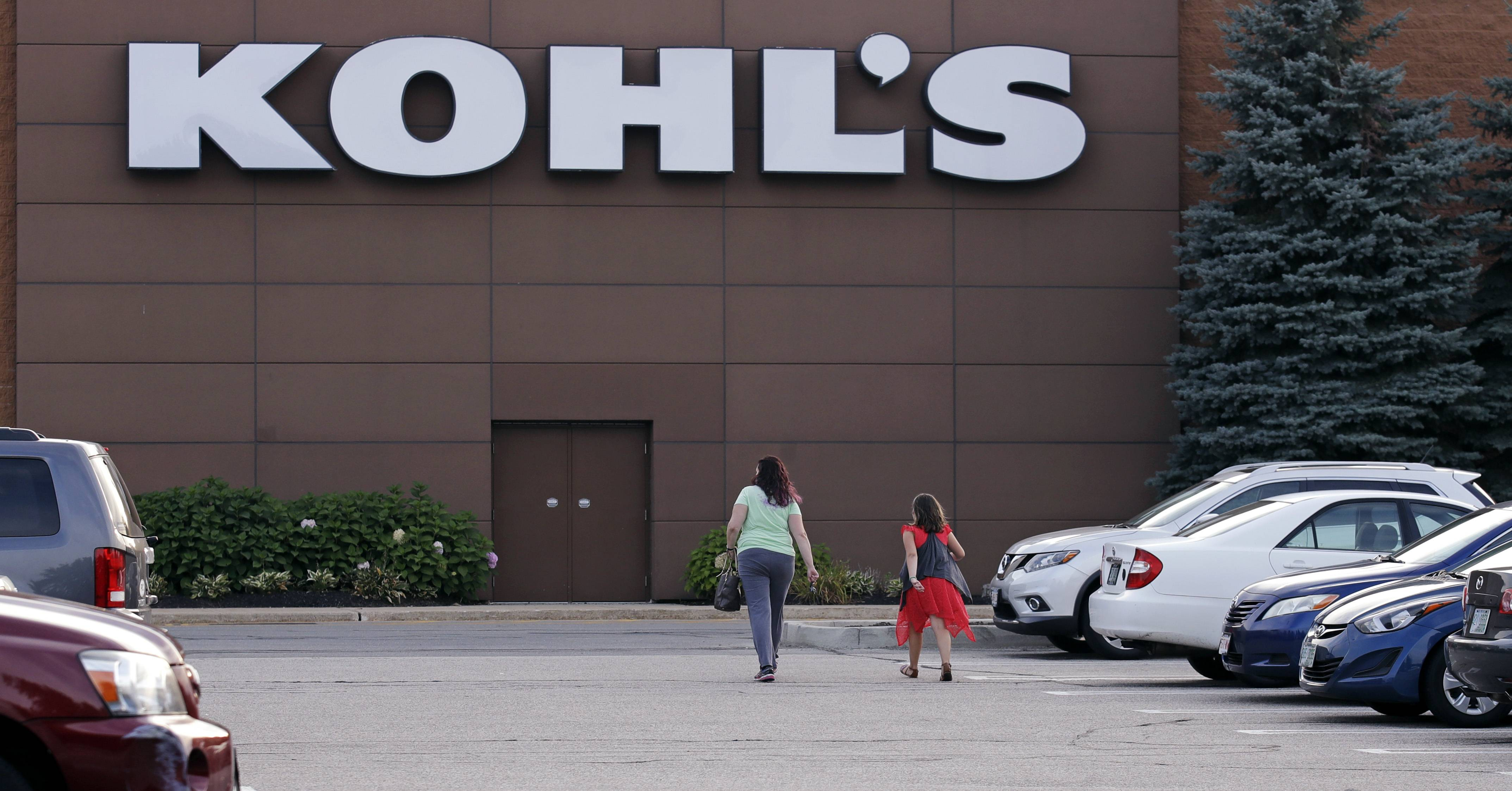 In this Tuesday, Aug. 22, 2017, photo, shoppers walk to a Kohl's retail store in Salem, N.H. Kohl's, which is opening some in-store Amazon shops, will start accepting returns for the online retailer at some of its stores in Los Angeles and Chicago starting in October 2017. (AP Photo/Charles Krupa)