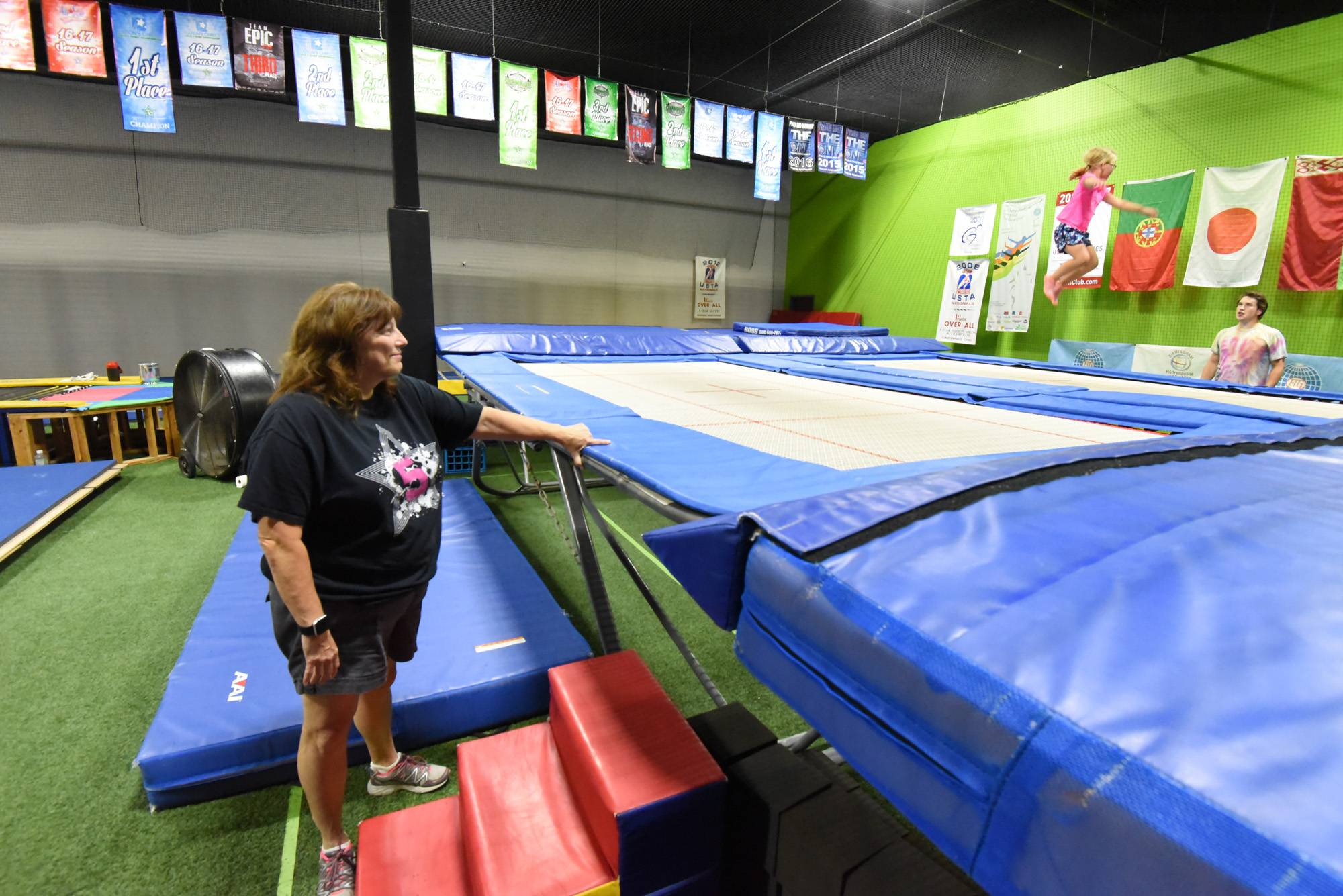 Paulette Konstantaras, owner of 5 Star Elite, watches instructor Josh Coles work with young gymnasts on a trampoline at Lifezone 360 in West Dundee.