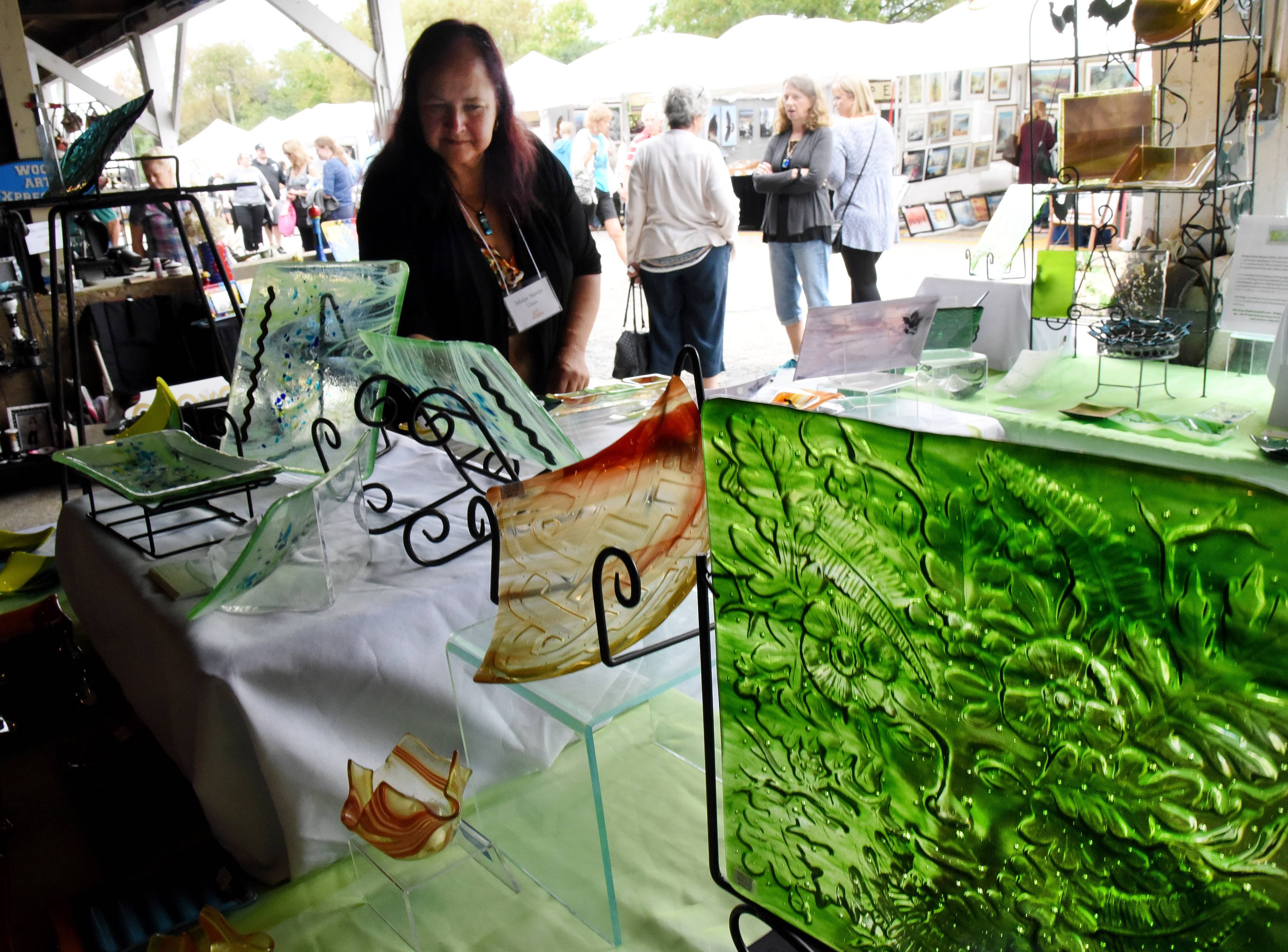 Marija Steele of Crystal Lake displays her fused glass art at Art in the Barn on the grounds of Advocate Good Shepherd Hospital. This year's show will feature the work of 175 artists.