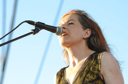 FILE - In this April 11, 2014 file photo, Neko Case performs at the Coachella Music and Arts Festival in Indio, Calif. Fire investigators are looking for the cause of a fire on Monday, Sept. 18, 2017, that heavily damaged Case's 225-year-old Vermont home. There were no injuries, though a barn was destroyed. It took firefighters two hours to extinguish the blaze. (Photo by Scott Roth/Invision/AP, File)