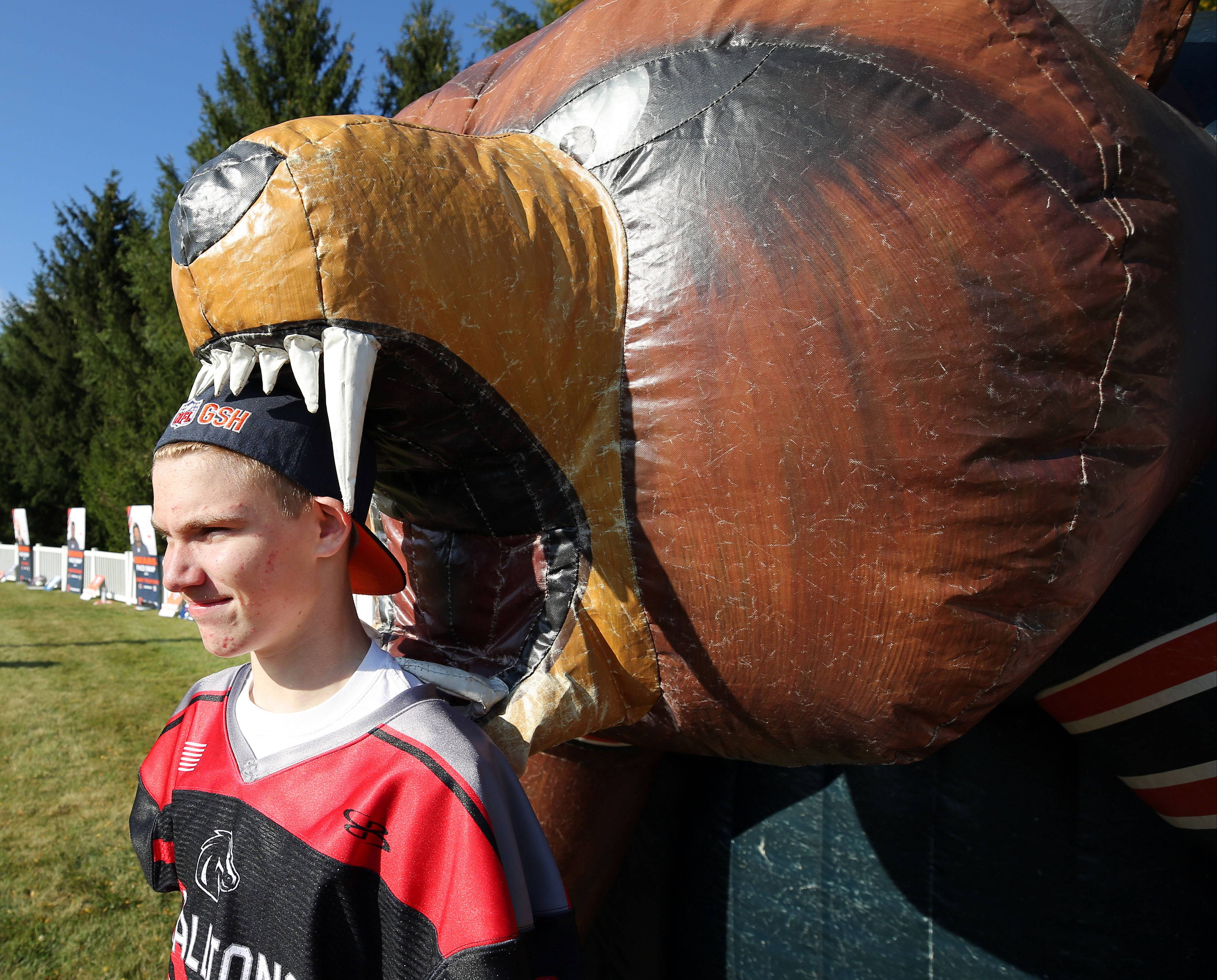 13-year-old Jacob Lichter of Wauconda poses for a picture in the mouth of an inflatable bear during a pep rally Tuesday for breast cancer awareness at Advocate Condell Medical Center in Libertyville.