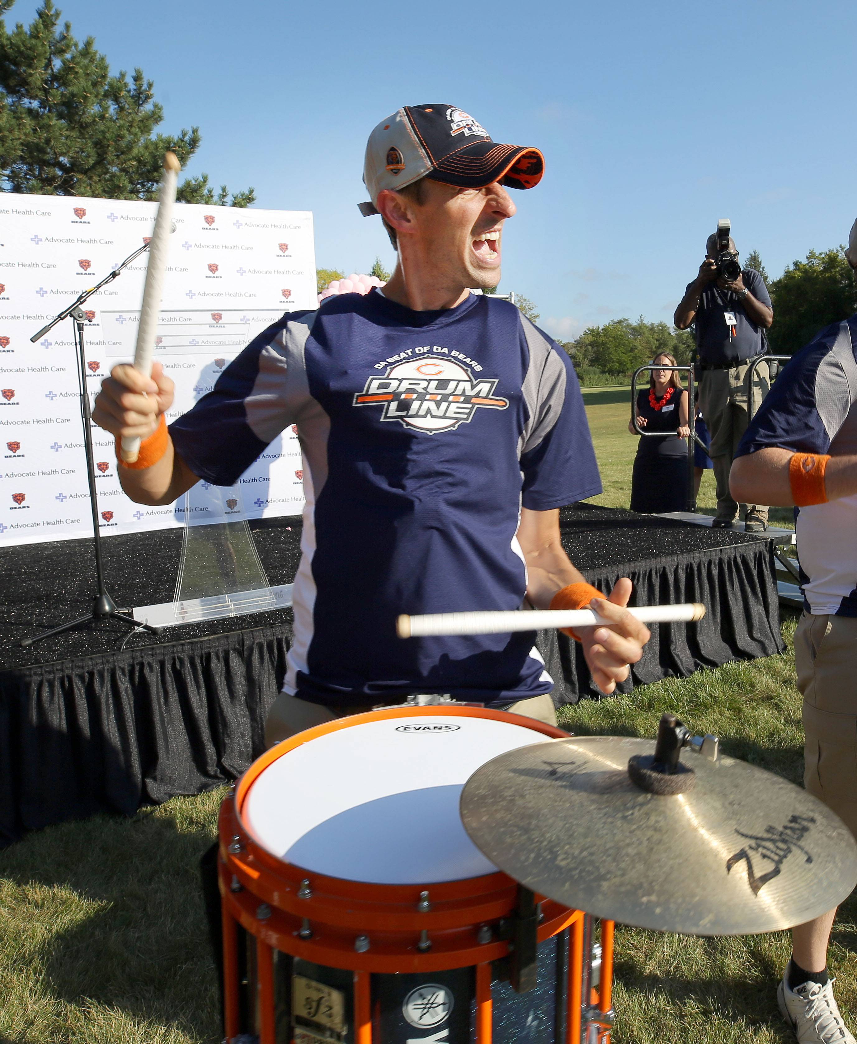 Kevin Gier of Lockport and the Chicago Bears Drum Line entertain people Tuesday during a pep rally for breast cancer awareness at Advocate Condell Medical Center in Libertyville.
