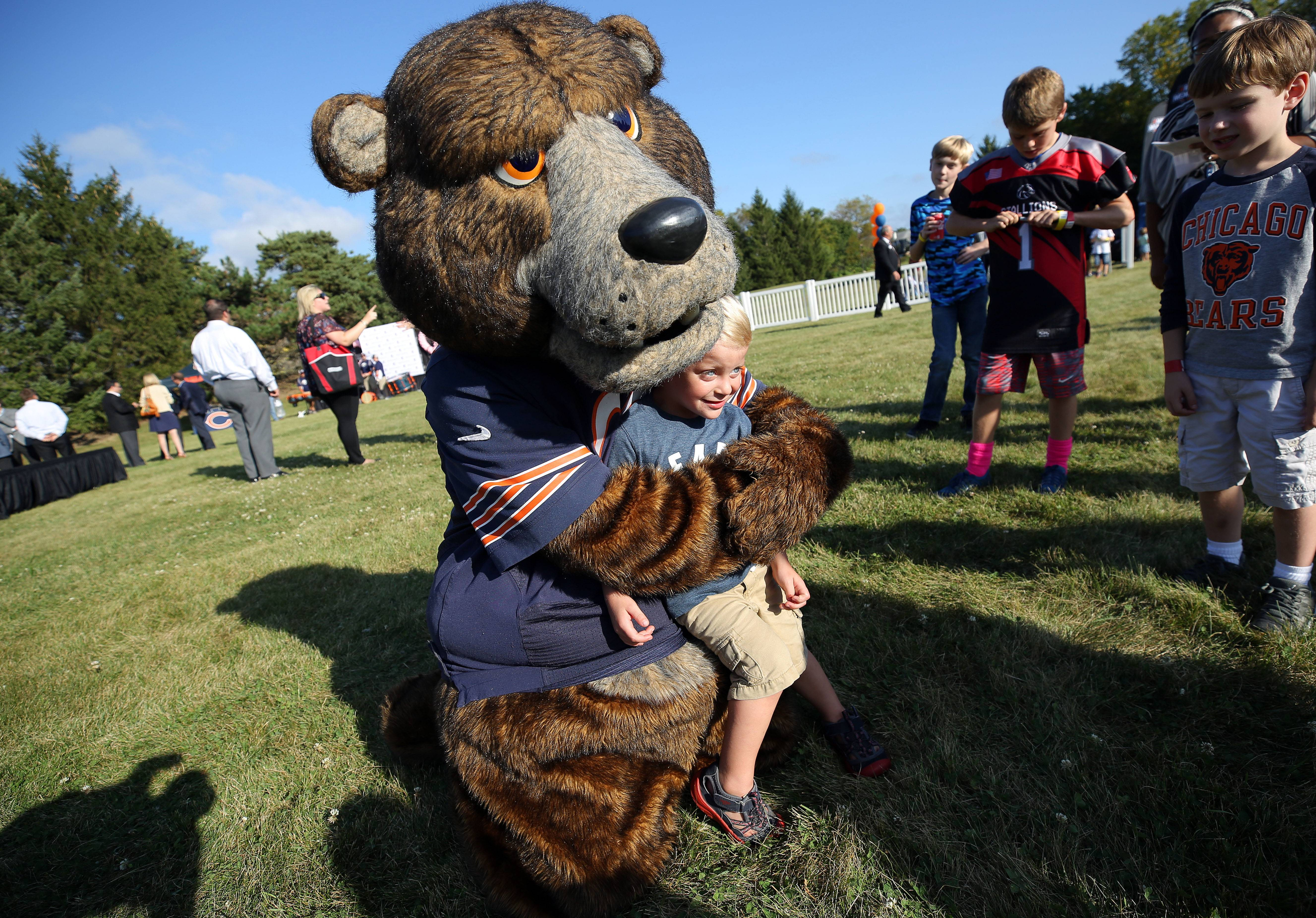 Kolton Lessner, 3, of Grayslake poses for a picture with Bears mascot Staley on Tuesday at Advocate Condell Medical Center in Libertyville.
