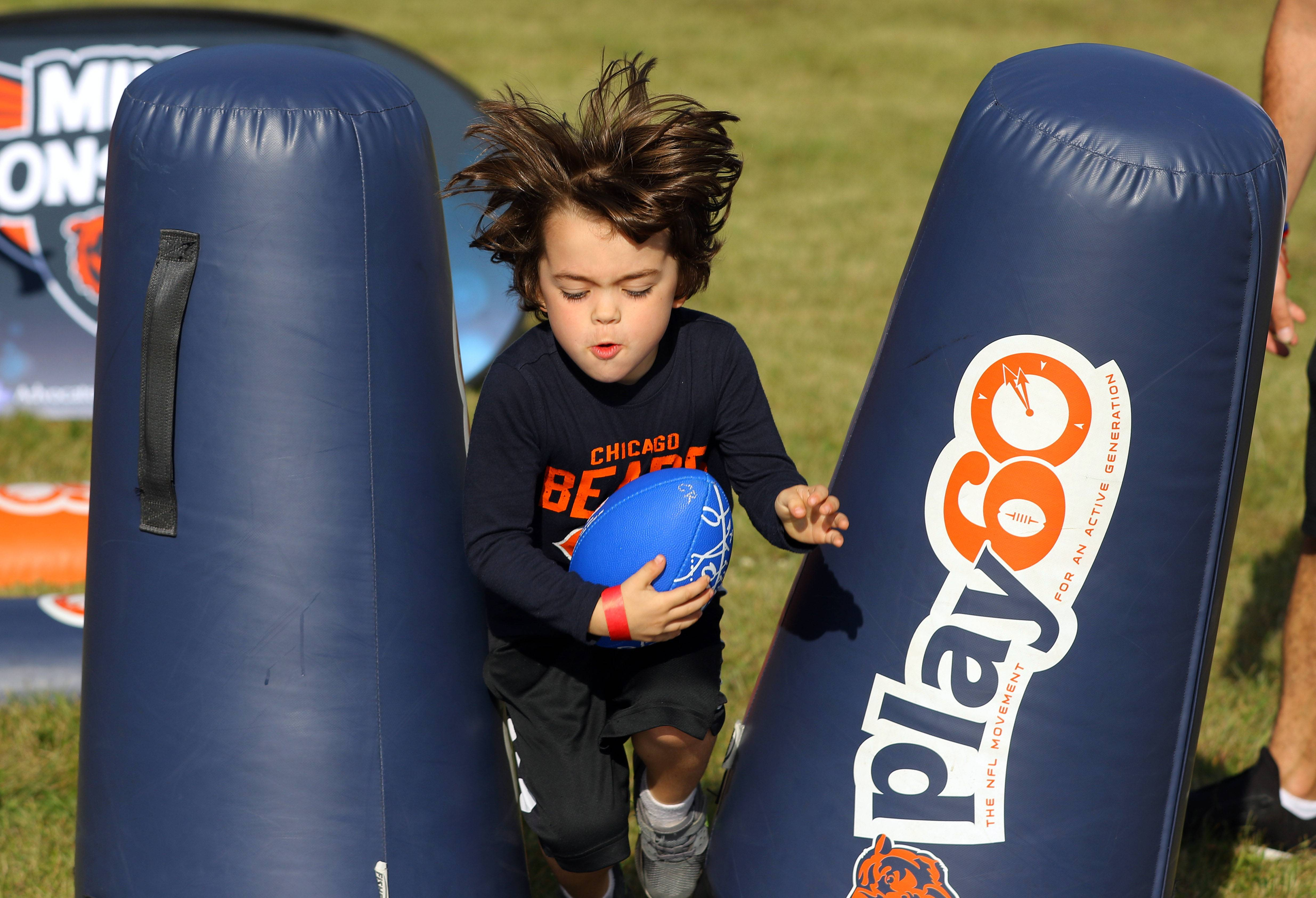Steve Lundy/slundy@dailyherald.comLincoln Skupien, 5, of Lake Zurich runs through an obstacle course as Advocate Health Care teamed up with the Chicago Bears during a pep rally for breast cancer awareness at Advocate Condell Medical Center in Libertyville Tuesday.