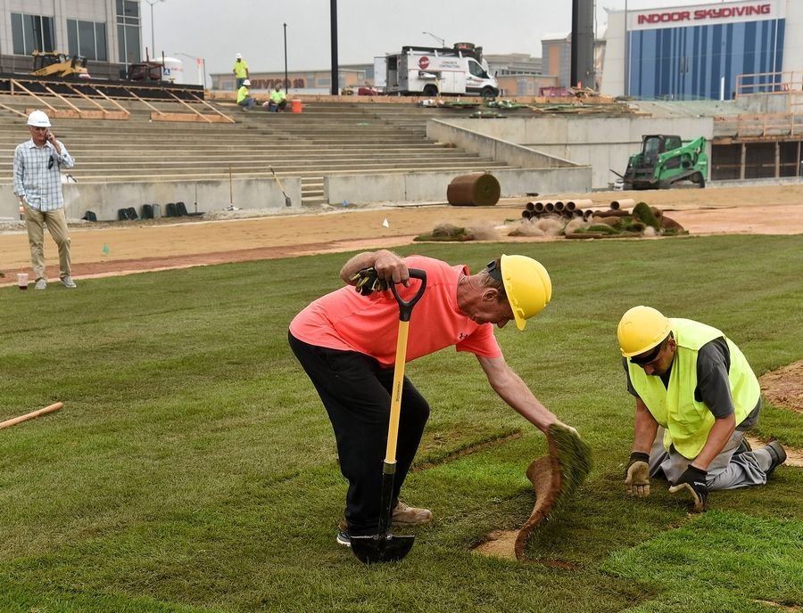 "Roger Bossard, better known as ""The Sodfather"" and head groundskeeper at Guaranteed Rate Field, installs sod Tuesday at Impact Field, the independent league baseball stadium under construction in Rosemont."