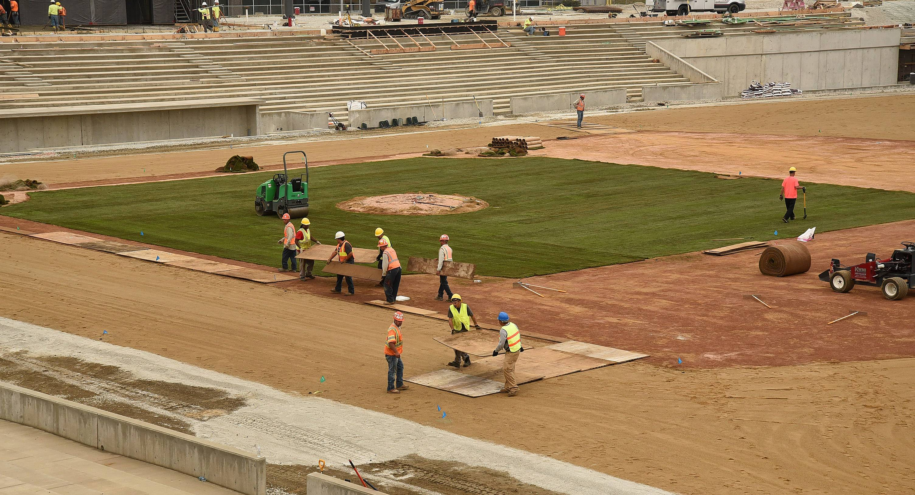Crews install infield sod Tuesday at Impact Field in Rosemont, a process overseen by Roger Bossard, the head groundskeeper at Guaranteed Rate Field.