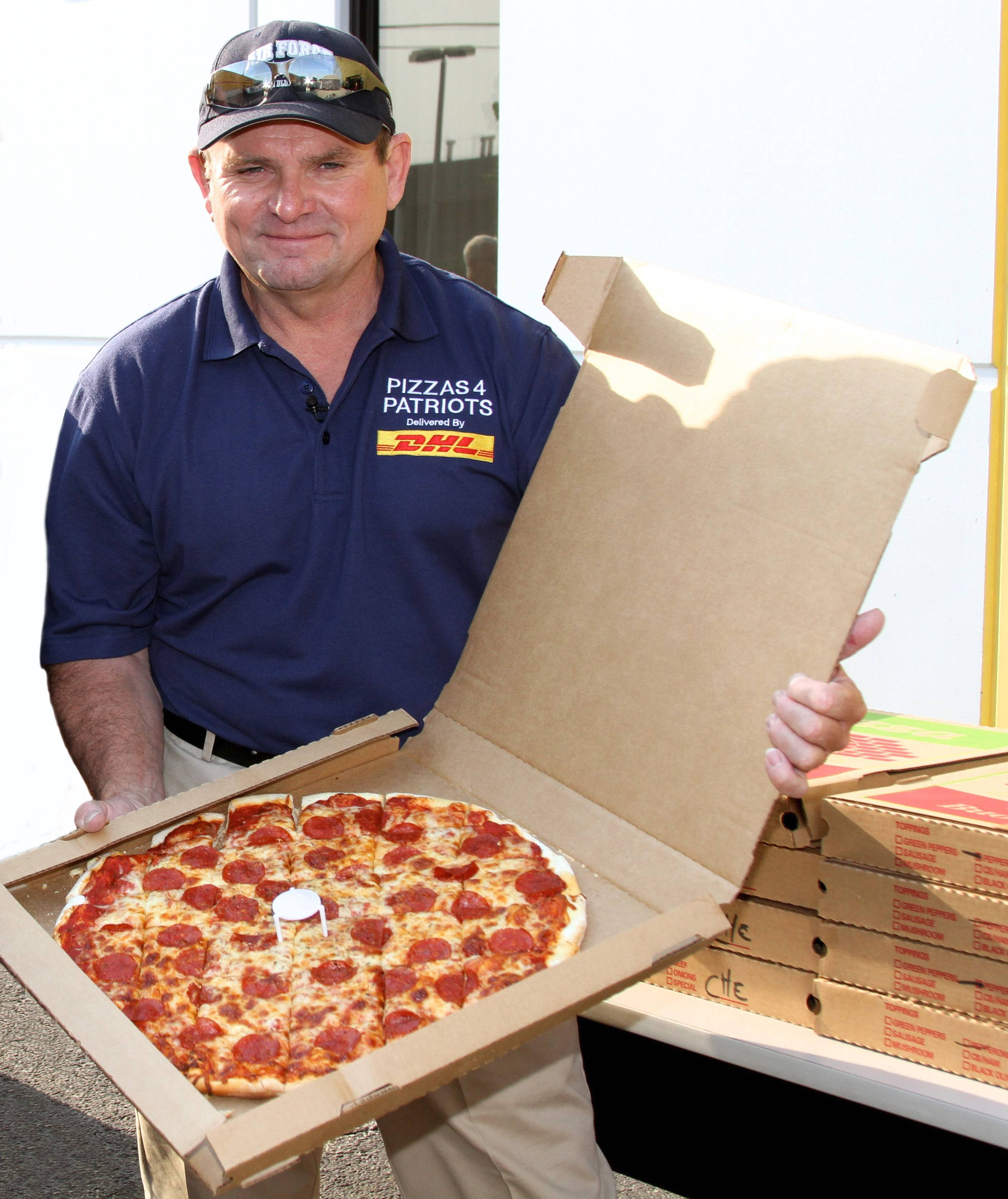 Courtesy of DHL ExpressMark Evans, a retired master sergeant from Elk Grove Village, has been delivering thousands of pizzas to troops in the Mideast for seven years now, with help from businesses that have backed the effort.