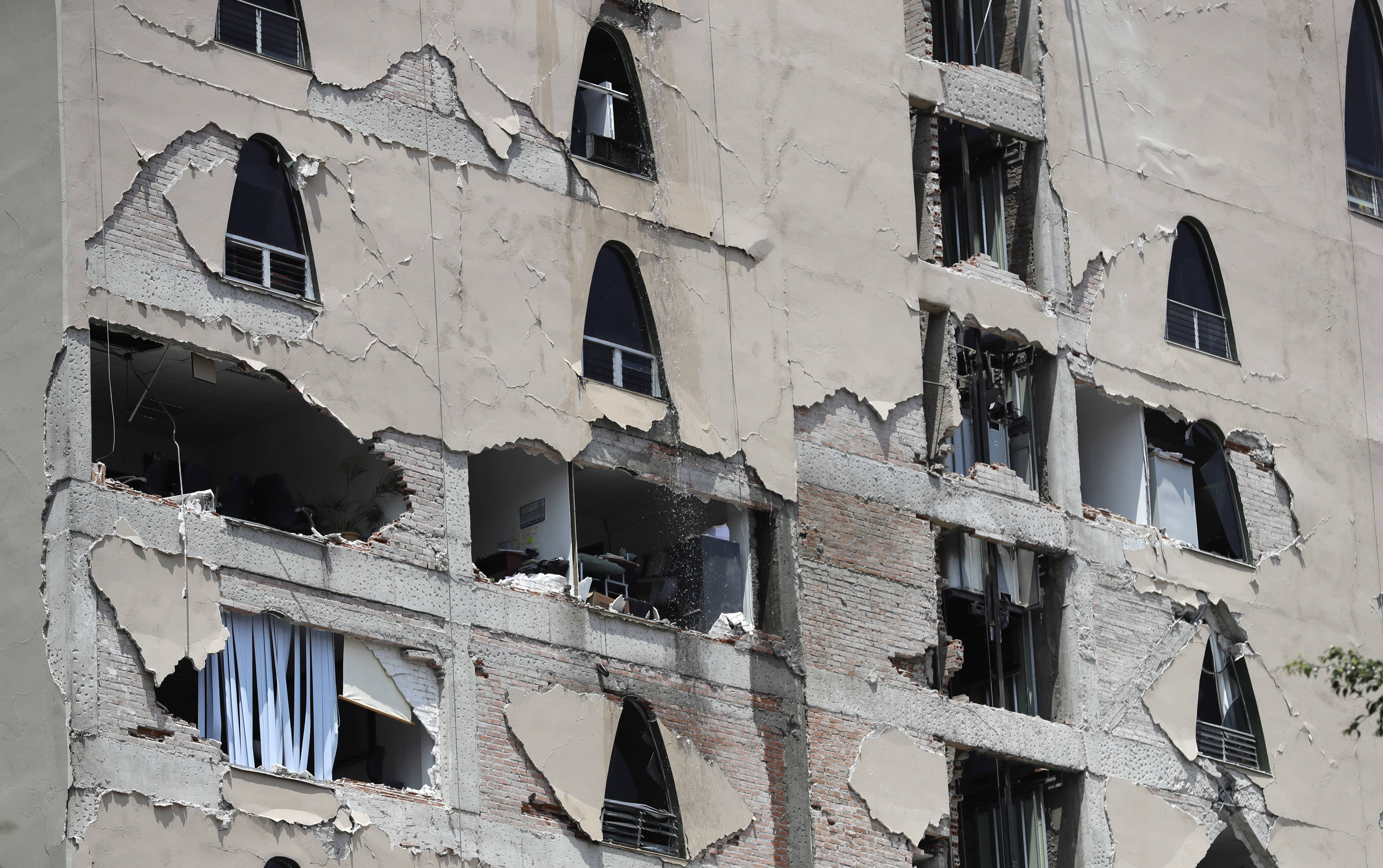 Remains of a damaged building Tuesday after an earthquake in Mexico City. A powerful earthquake has jolted Mexico, causing buildings to sway sickeningly in the capital on the anniversary of a 1985 quake that did major damage.