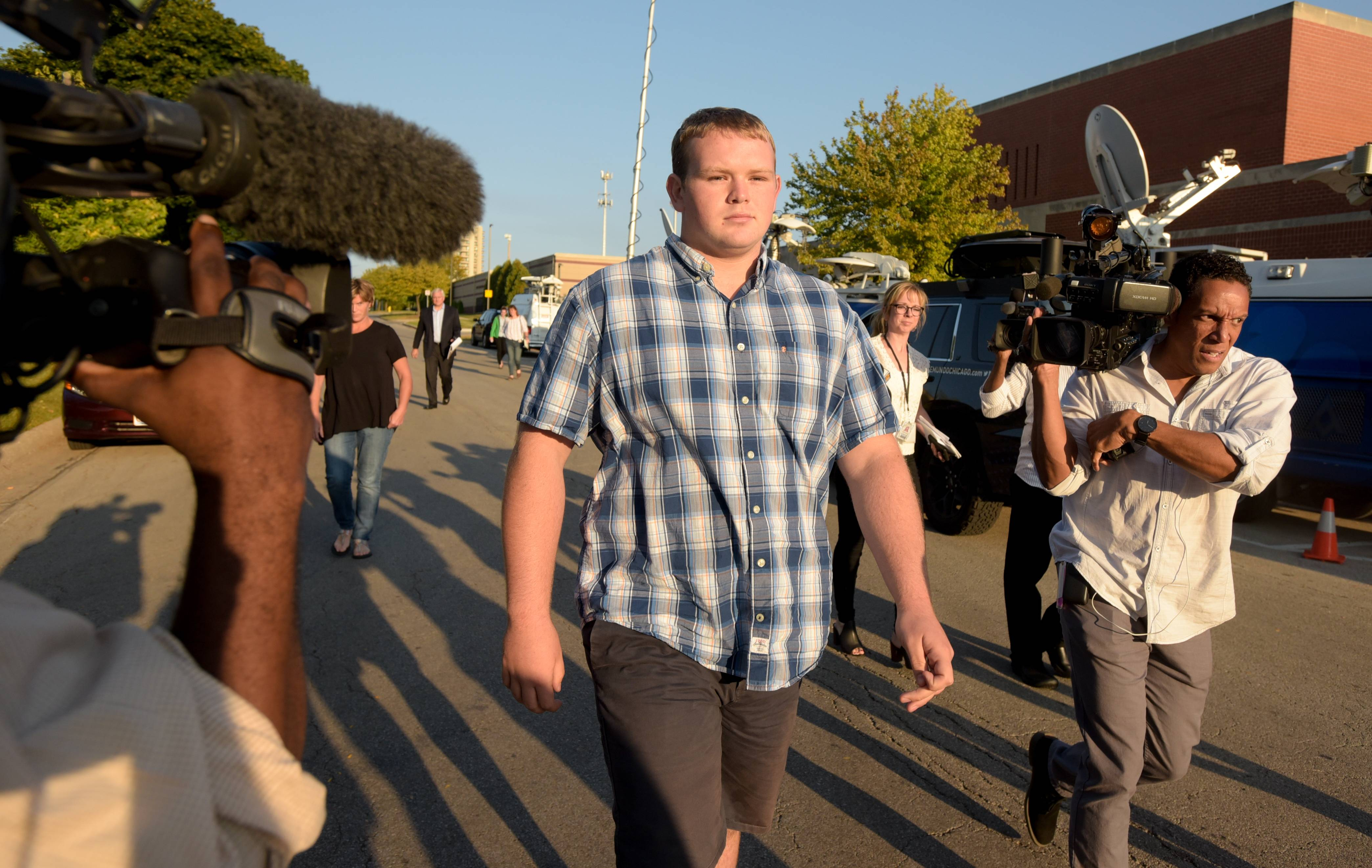 Wheaton College football player Kyler Kregel leaves the Wheaton police station Tuesday after posting bail.