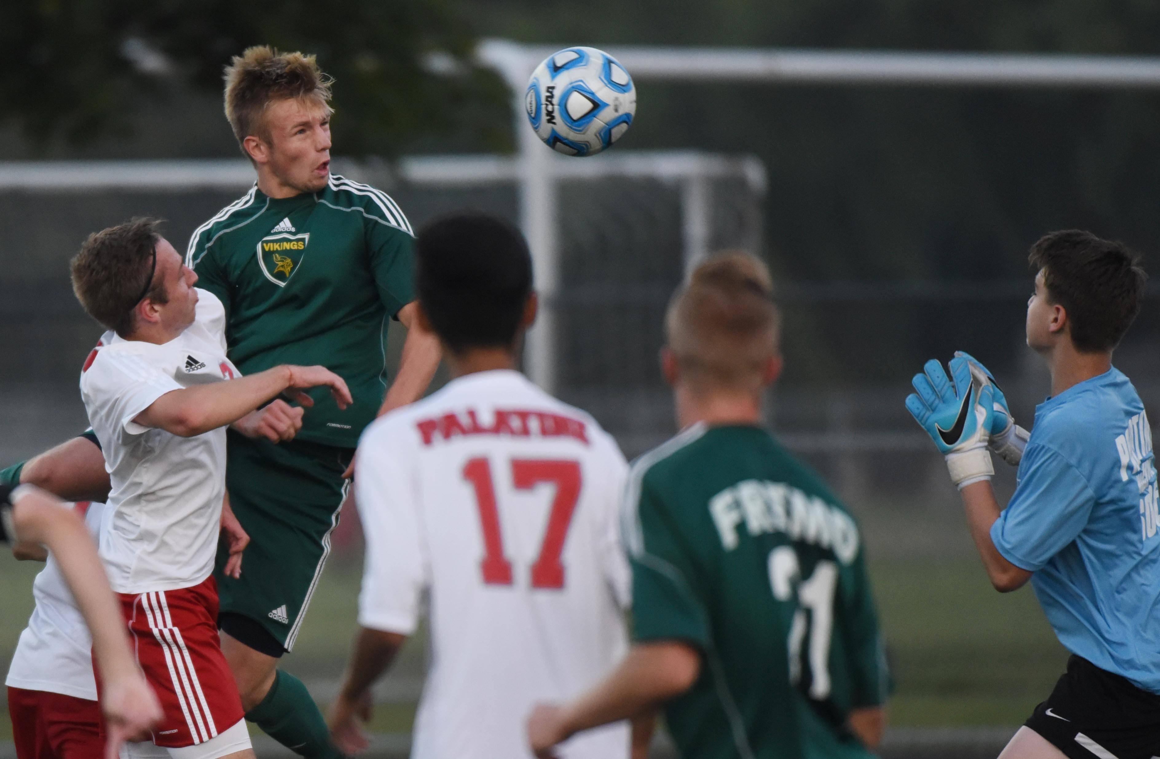 Fremd's Matt Austin directs the ball into Palatine's net for a first-half goal past keeper Ethan Bank during Tuesday's match at Palatine.