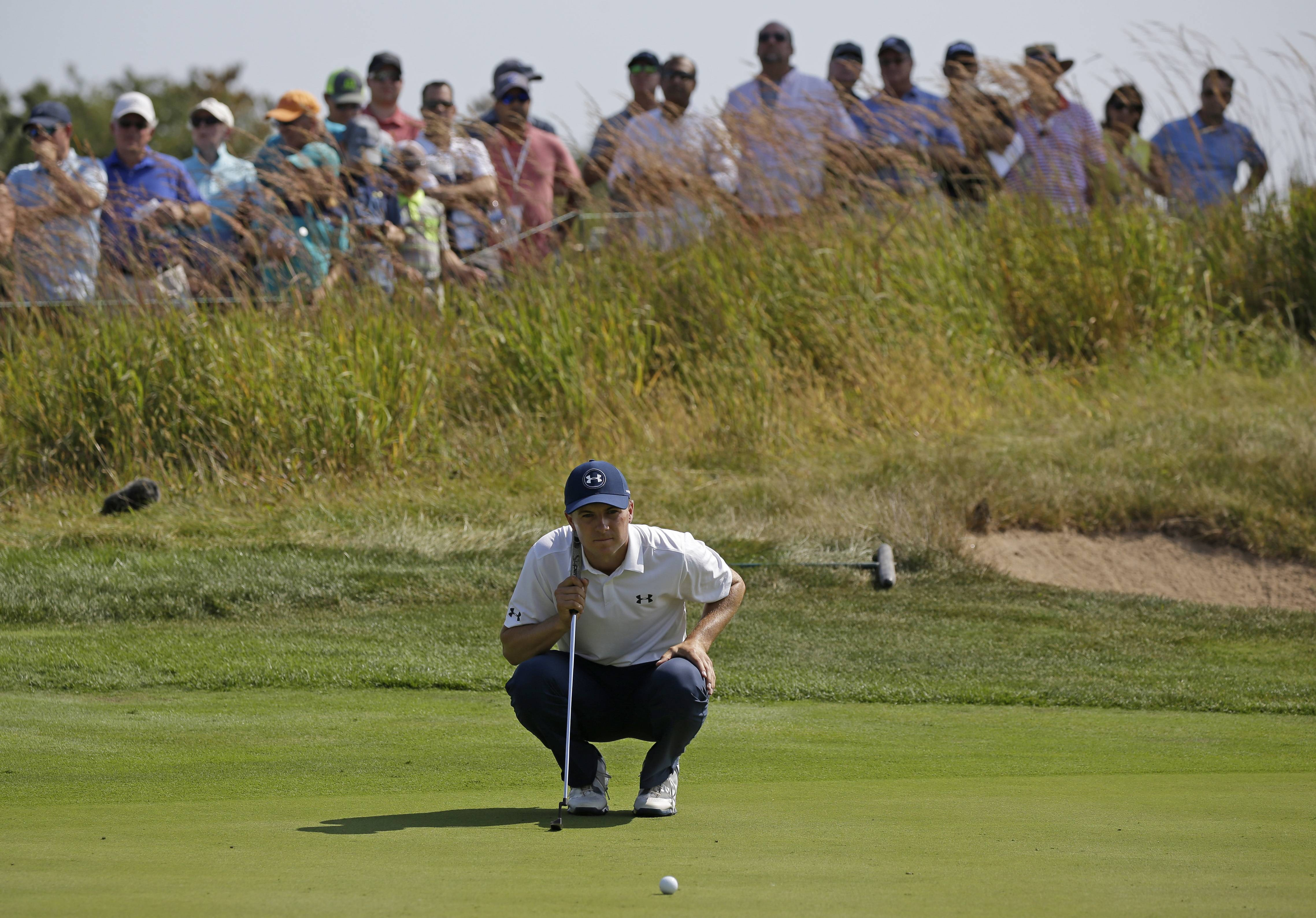 Jordan Spieth reads the green before his putt on the third hole during the second round of the BMW Championship golf tournament at Conway Farms Golf Club, Friday, Sept. 15, 2017, in Lake Forest, Ill. (AP Photo/Nam Y. Huh)