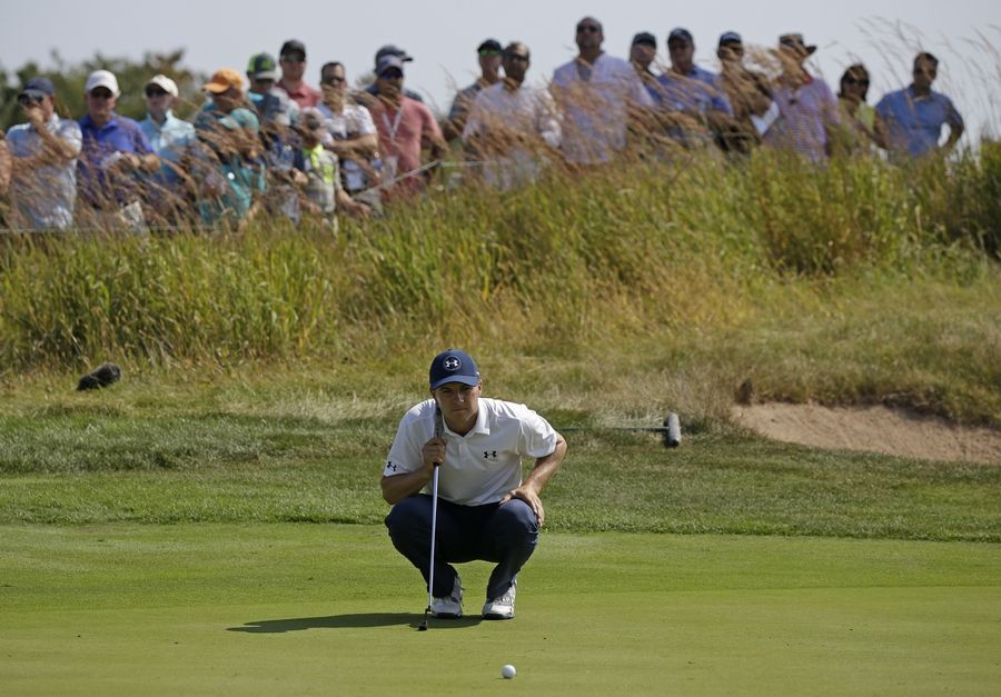 982f8b4df03b4 Jordan Spieth reads the green before his putt on the third hole during the  second round