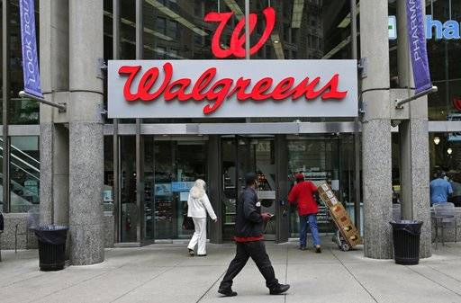 FILE - This June 4, 2014, file photo, shows a Walgreens retail store in Boston. Walgreens and Rite Aid have finally devised a combination of the nation's largest and third-largest drugstore chains that will get past anti-trust regulators. The companies said Tuesday, Sept. 19, 2017, that they have Federal Trade Commission clearance for a slimmer version of a store-purchase agreement announced in June. (AP Photo/Charles Krupa, File)
