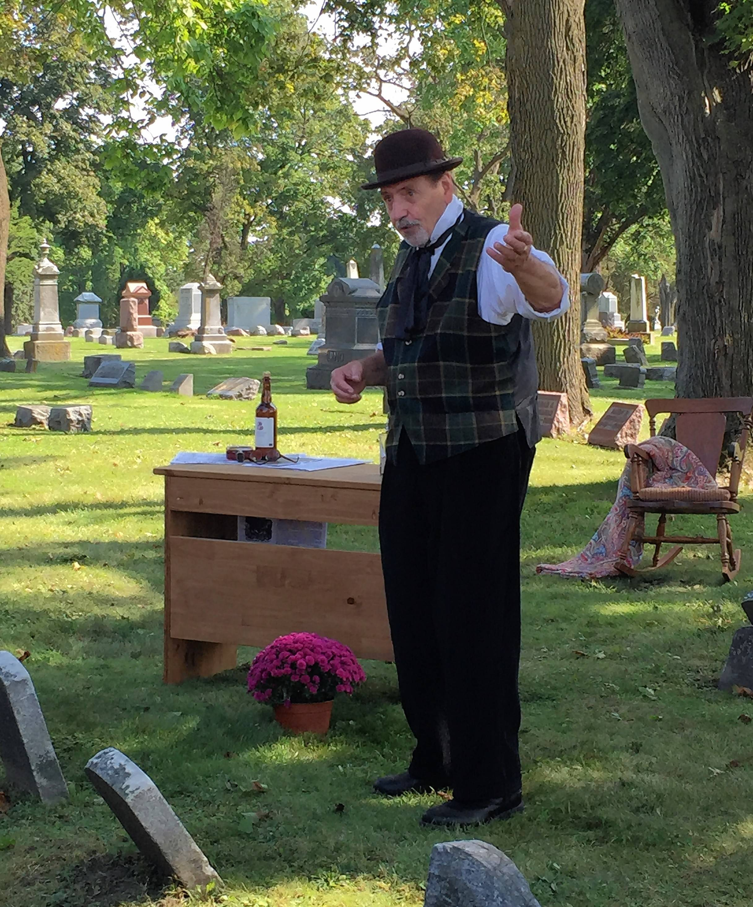 Actor August Conte portrays Joseph Pabst at the 29th annual Cemetery Walk in Elgin's Bluff City Cemetery. Conte returns to this year's walk to portray Gilbert Snow, inventor of the self-oiling windmill and founder of the Elgin Wind, Power and Pump Co.