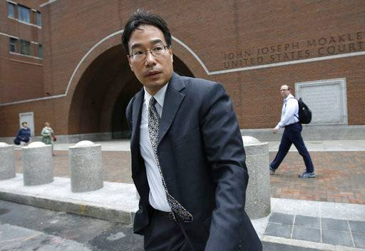 Glenn Chin, the supervisory pharmacist at the now-closed New England Compounding Center, departs federal court after attending the first day of his trial, Tuesday, Sept. 19, 2017, in Boston. Chin is charged with second-degree murder and other crimes under federal racketeering law for his role in the 2012 fungal meningitis outbreak that killed 76 people and sickened hundreds of others. (AP Photo/Steven Senne)