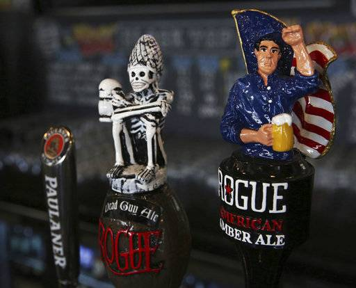 This Sunday, Sept. 10, 2017 photo, shows draft tap handles for beers from Newport, Oregon's Rogue Ales brewery, at the Black Tap restaurant in Dubai, United Arab Emirates. Dubai long has been known for its clubbing scene and cocktail bars, but there's a new thirst for craft beer. New businesses are springing up and exotic brews are replacing the country's standard lagers.