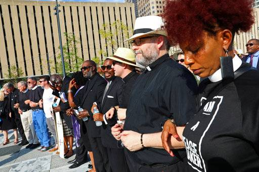 CORRECTS TO SERVICE-Clergy pray together during in an interfaith prayer service calling for peace and solidarity at Kiener Plaza on Tuesday, Sept. 19, 2017, in St. Louis. Leaders of several faiths on Tuesday called for peace and justice amid the turmoil that followed the acquittal of a white former St. Louis police officer in the 2011 death of a black man. (Christian Gooden/St. Louis Post-Dispatch via AP)