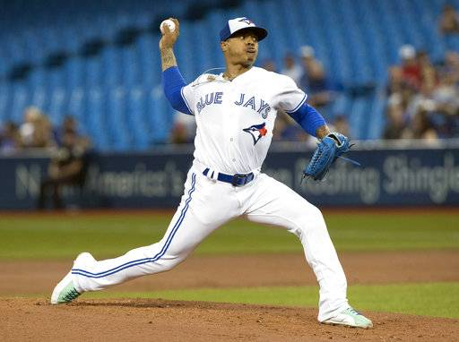 Toronto Blue Jays starting pitcher Marcus Stroman throws against the Kansas City Royals during the first inning of a baseball game, Tuesday, Sept. 19, 2017 in Toronto. (Fred Thornhill /The Canadian Press via AP)