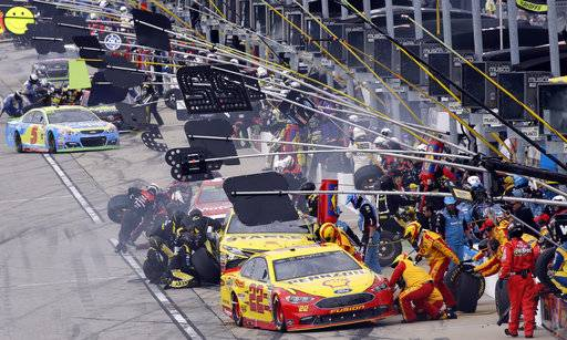 Joey Logan (22) makes a pit stop during a NASCAR Cup Monster Energy Series auto race at Chicagoland Speedway in Joliet, Ill., Sunday, Sept. 17, 2017. (AP Photo/Nam Y. Huh)