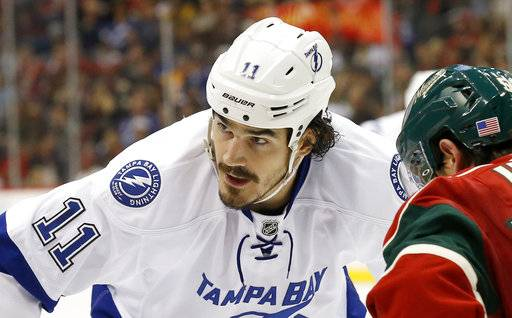 FILE - In this Nov. 7, 2015, file photo, Tampa Bay Lightning center Brian Boyle (11) gets into position for a face-off against Minnesota Wild left wing Erik Haula (56) during the second period of an NHL hockey game in St. Paul, Minn. Boyle, 32, who signed a $5.5 million, two-year deal with the New Jersey Devils in July, has been diagnosed with chronic myeloid leukemia, a type of bone-marrow cancer that the team's doctor says can be treated with medication, the Devils announced Tuesday, Sept. 19, 2017. (AP Photo/Ann Heisenfelt, File)
