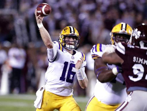 LSU quarterback Danny Etling (16) attempts a pass as he is being rushed by a Mississippi State defender during the second half of their NCAA college football game against LSU in Starkville, Miss., Saturday, Sept. 16, 2017. Mississippi State won 37-7. (AP Photo/Rogelio V. Solis)