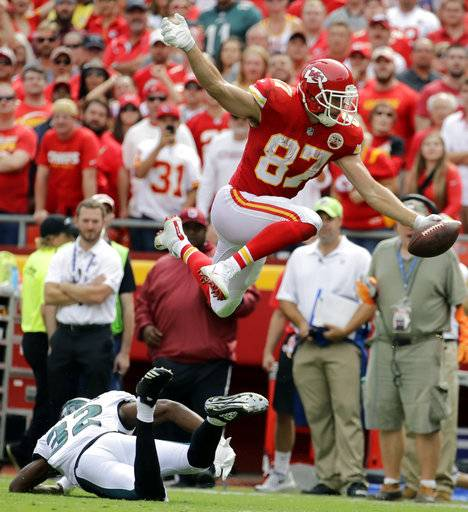 Kansas City Chiefs tight end Travis Kelce (87) vaults over Philadelphia Eagles cornerback Rasul Douglas (32) during the second half of an NFL football game in Kansas City, Mo., Sunday, Sept. 17, 2017. (AP Photo/Charlie Riedel)