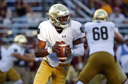 Notre Dame's Brandon Wimbush looks to pass during the second half of an NCAA college football game against Boston College in Boston, Saturday, Sept. 16, 2017. Notre Dame won 49-20. (AP Photo/Michael Dwyer)