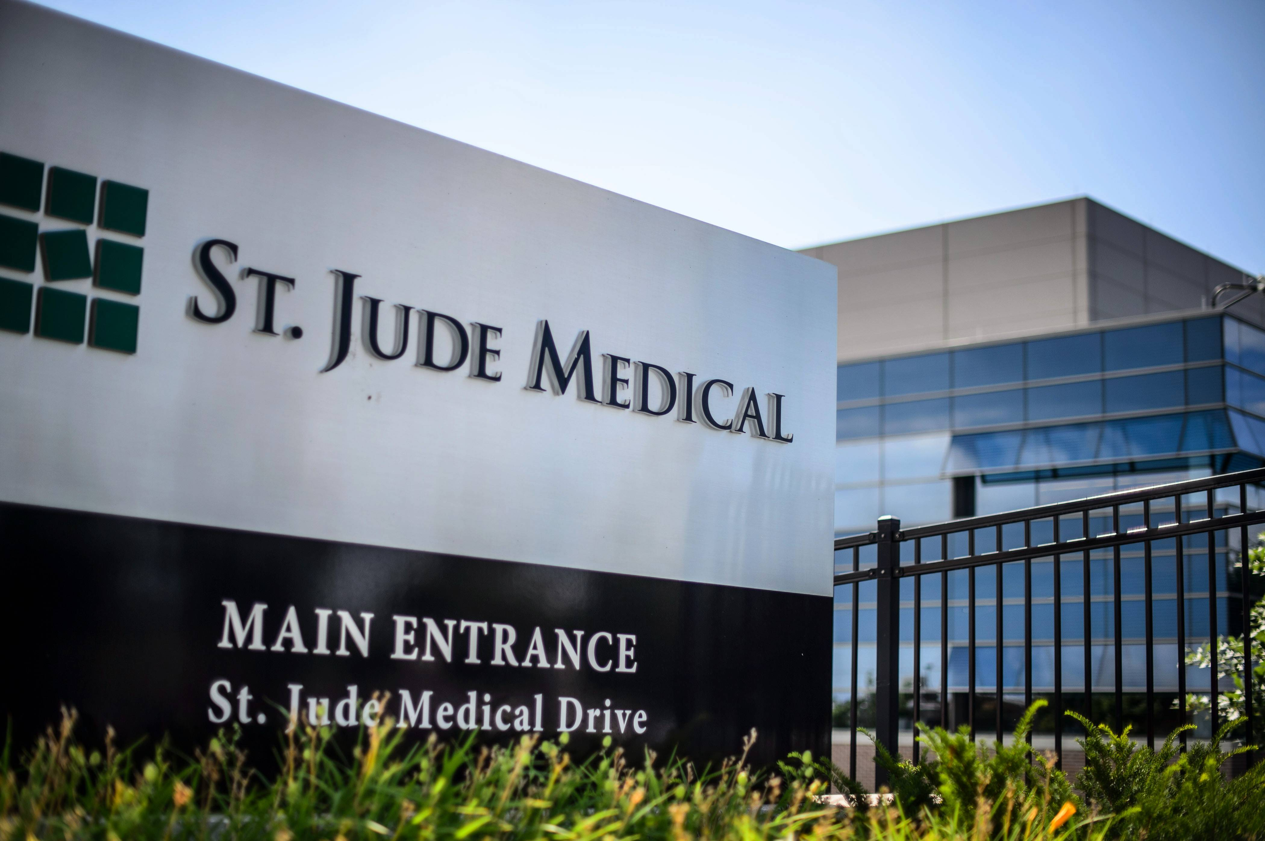 St. Jude Medical and its parent company, Libertyville Township-based Abbott Laboratories, are the subjects of a class-action lawsuit claiming St. Jude failed to act quickly in the recall of defective cardiac defibrillator devices.