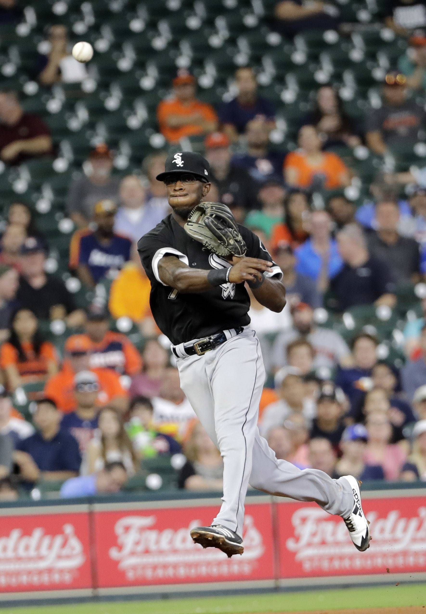 Chicago White Sox shortstop Tim Anderson throws to first for the out after fielding a ground ball by Houston Astros' Carlos Correa during the fourth inning of a baseball game Tuesday, Sept. 19, 2017, in Houston.