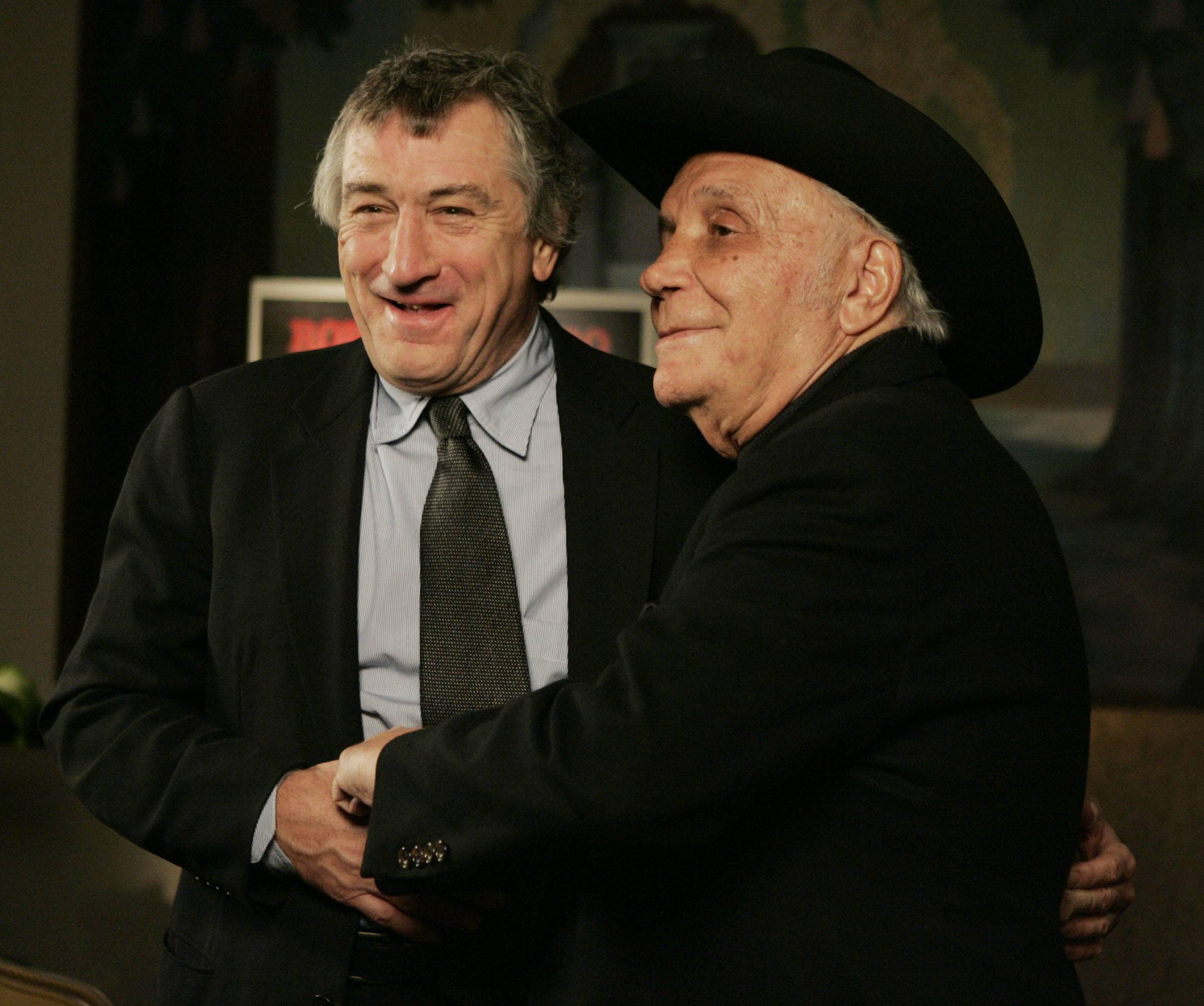 "Robert DeNiro, left, and boxer Jake LaMotta attended a 25th anniversary screening of the movie ""Raging Bull"" in New York. LaMotta, whose life was depicted in the film ""Raging Bull,"" died Tuesday, Sept. 19, 2017, at a Miami-area hospital from complications of pneumonia. He was 95."