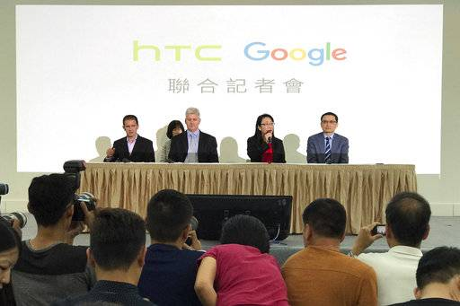 Cher Wang, chairperson of HTC, second from right, speaks during a press conference in New Taipei City, Taiwan, Thursday, Sept. 21, 2017. Google is biting off a big piece of device manufacturer HTC for $1.1 billion to expand its efforts to build phones, speakers and other gadgets equipped with its arsenal of digital services. With Wang is, from left, Mario Queiroz, vice president of product management at Google, Rick Osterloh, senior vice president of hardware for Google, and Chia-Lin Chang, president of smartphones and connected devices for HTC.