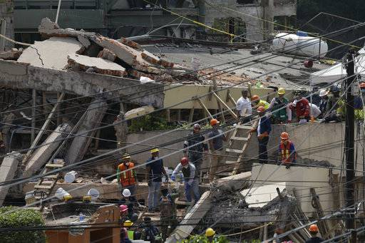 Search and rescue efforts continue at the Enrique Rebsamen school that collapsed after an earthquake in Mexico City, Wednesday, Sept. 20, 2017. Police, firefighters and ordinary Mexicans dug frantically through the rubble of collapsed schools, homes and apartment buildings early Wednesday, looking for survivors of Mexico's deadliest earthquake in decades as the number of confirmed fatalities climbs. One of the most desperate rescue efforts was at this school, where a wing of the three-story building collapsed Tuesday into a massive pancake of concrete slabs.