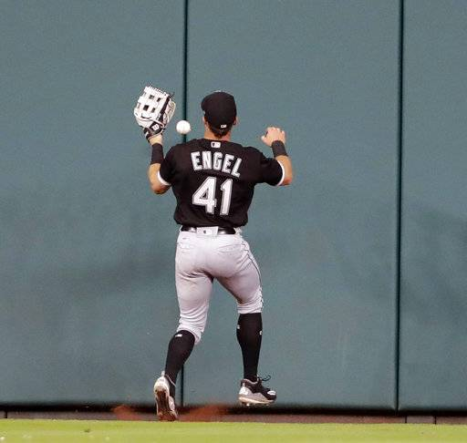 Chicago White Sox center fielder Adam Engel tries to catch a triple by Houston Astros' Josh Reddick during the seventh inning of a baseball game Wednesday, Sept. 20, 2017, in Houston.