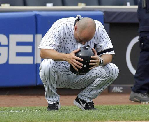 New York Yankees third base coach Joe Espada reacts after a young girl was hit by a line drive during the fifth inning of a baseball game against the Minnesota Twins Wednesday, Sept.20, 2017, at Yankee Stadium in New York.