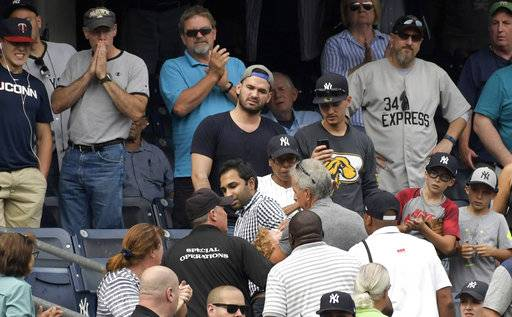 Baseball fans reacts as a young girl is carried out of the seating area after being hit by a line drive during the fifth inning of a baseball game between the New York Yankees and Minnesota Twins, Wednesday, Sept. 20, 2017, at Yankee Stadium in New York.