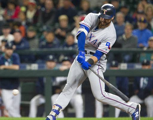 Texas Rangers first baseman Joey Gallo swings low to make contact on a groundout to score Texas Rangers' Adrian Beltre in the second inning of a baseball game ,Tuesday, Sept. 19, 2017, in Seattle.