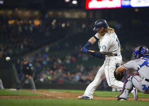Seattle Mariners' Ben Gamel hits an RBI double off of Texas Rangers starting pitcher Martin Perez in the fifth inning of a baseball game, Tuesday, Sept. 19, 2017, in Seattle.