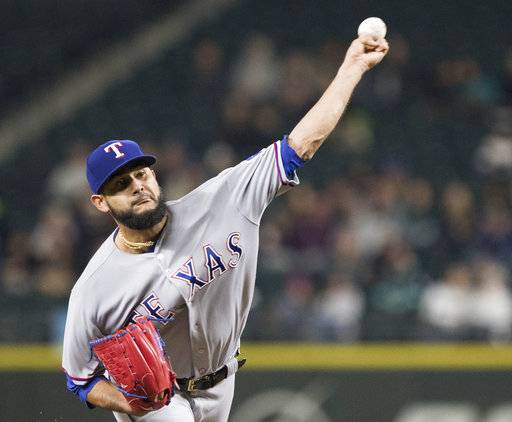 Texas Rangers starting pitcher Martin Perez delivers against the Seattle Mariners in the fifth inning of a baseball game, Tuesday, Sept. 19, 2017, in Seattle.