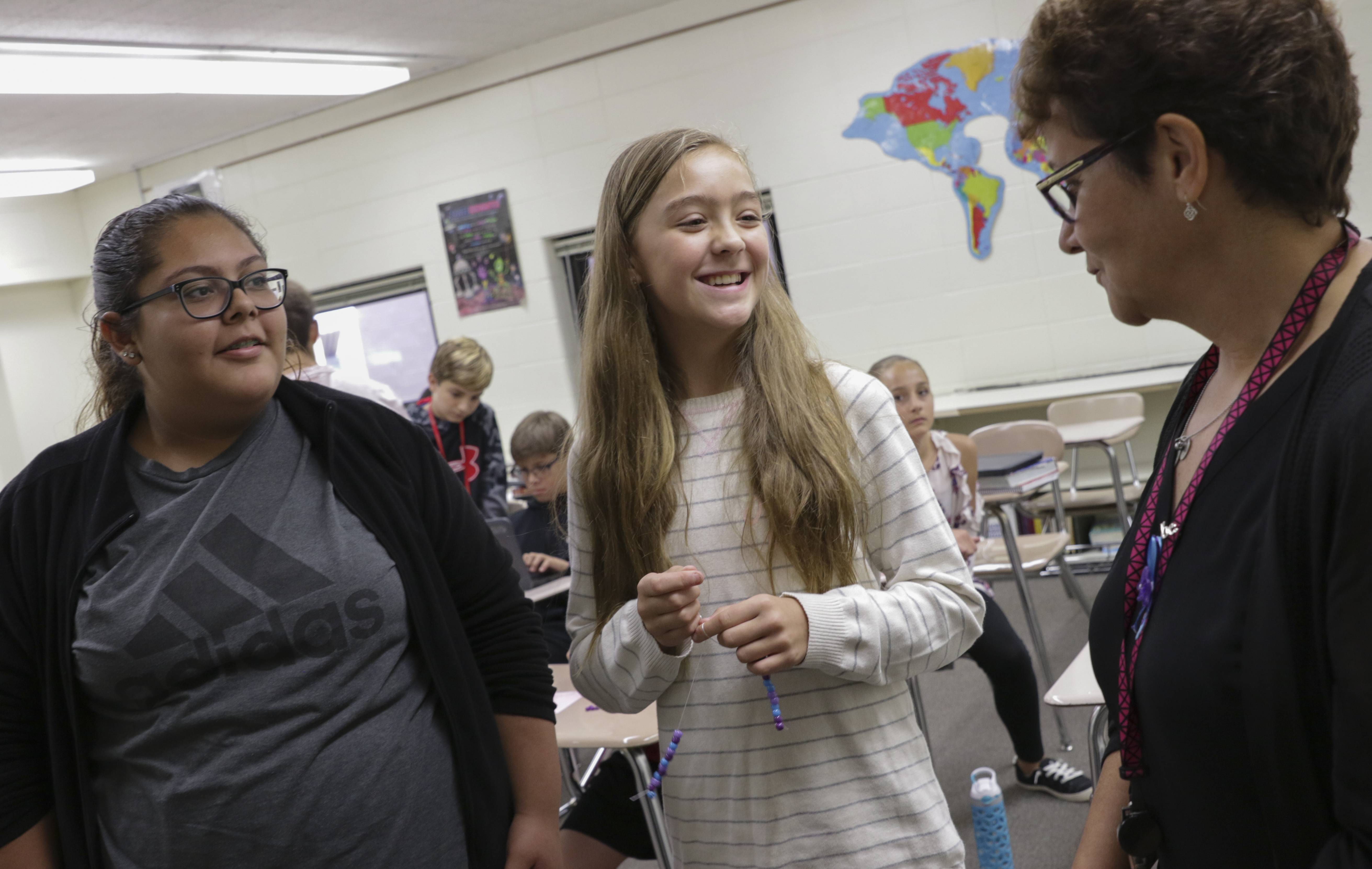 Fischer Middle School seventh-graders Monica Vergara and Emily Shanz made suicide prevention awareness bracelets for everyone in their class this year after learning their language arts and social studies teacher, Mary Kay Gleason lost her daughter to suicide nearly three years ago.