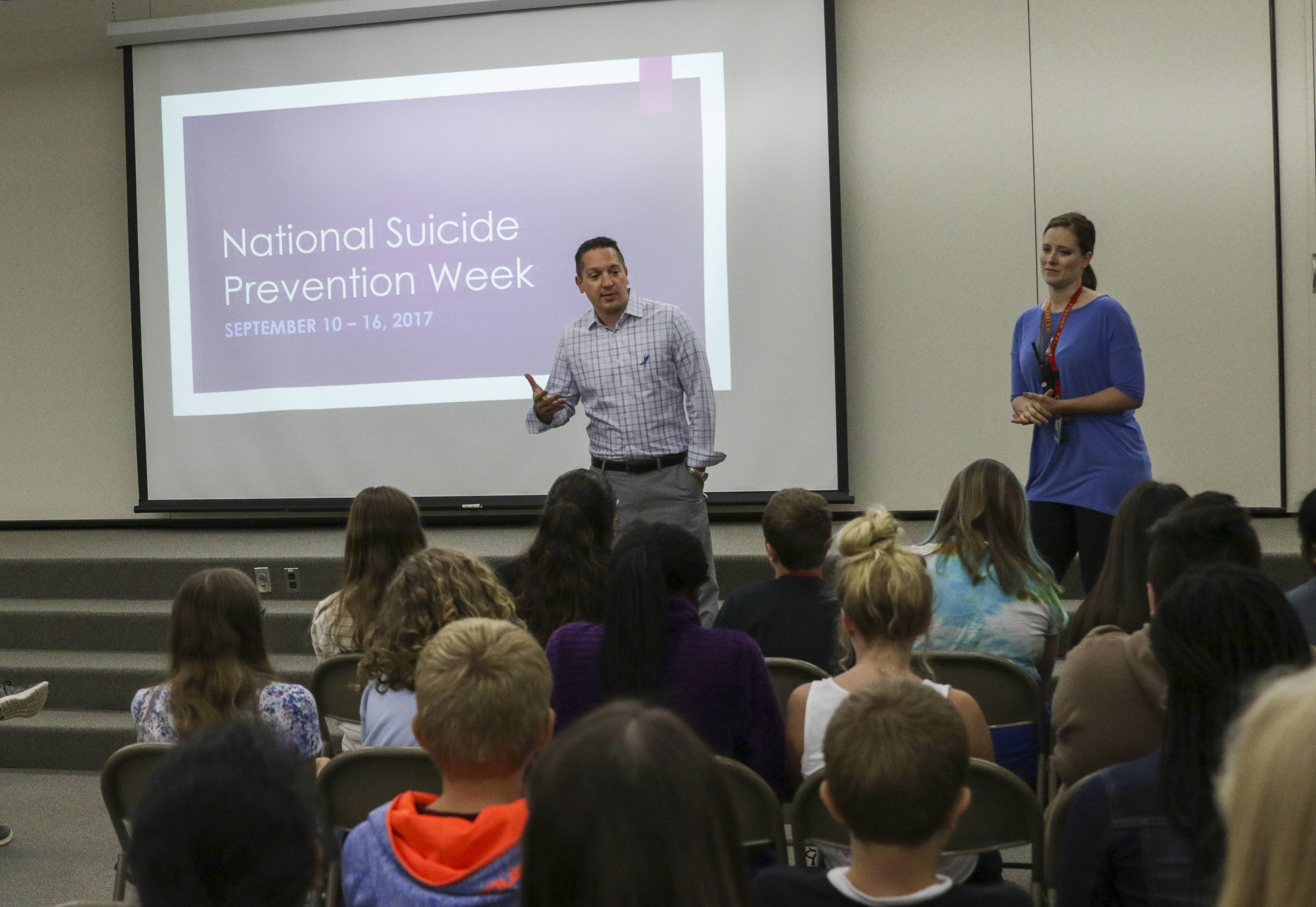 Jake Rebus, school psychologist, and Katey Kollereb, social worker at Fischer Middle School in Aurora, share suicide facts, risk factors, warning signs and prevention tips with seventh graders during a new initiative led by teacher Mary Kay Gleason, who lost her daughter to suicide nearly three years ago.