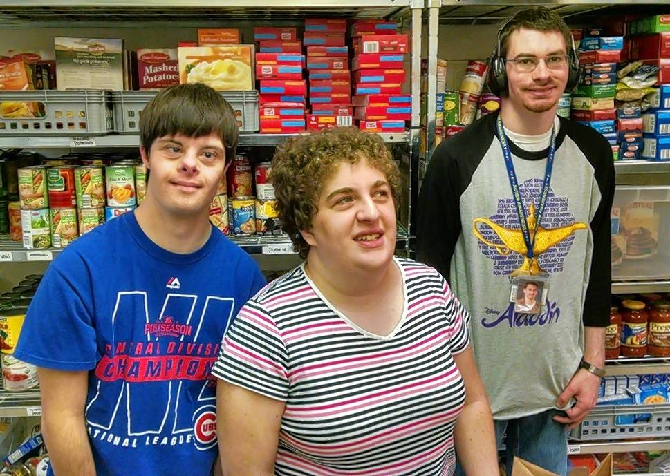 Current REACH members Matt, Katherine and Billy volunteer at the Elk Grove Township Food Pantry.