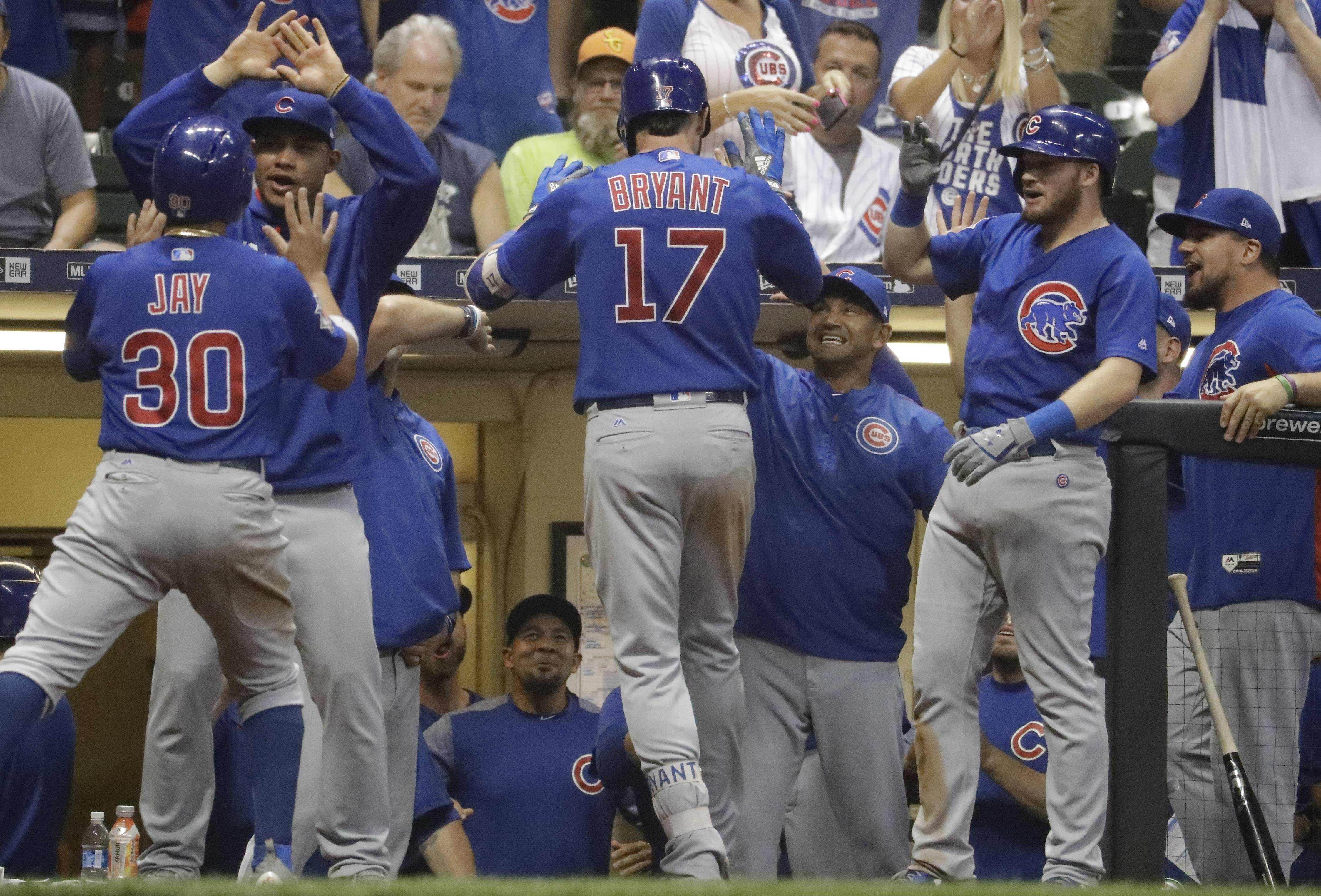 Chicago Cubs' Kris Bryant is congratulated after hitting a two-run home run during the 10th inning of a baseball game against the Milwaukee Brewers Thursday, Sept. 21, 2017, in Milwaukee. (AP Photo/Morry Gash)