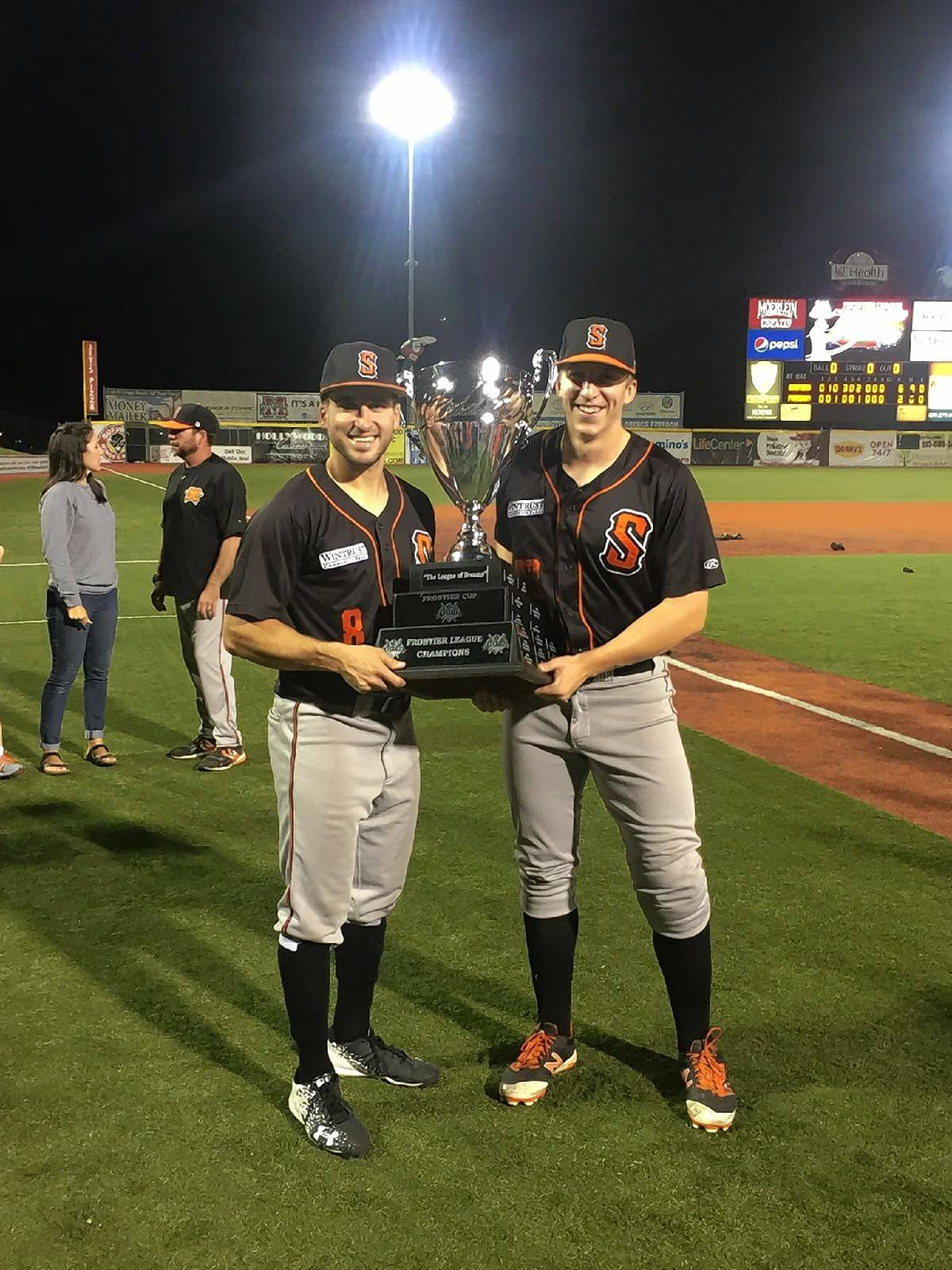 Rob McDonnell, right, is joined by Schaumburg Boomers teammate Kyle Ruchim after they helped produce a Frontier League championship this summer. McDonnell, a Barrington grad, had a strong season out of the bullpen and hopes affiliated baseball gives him another look.