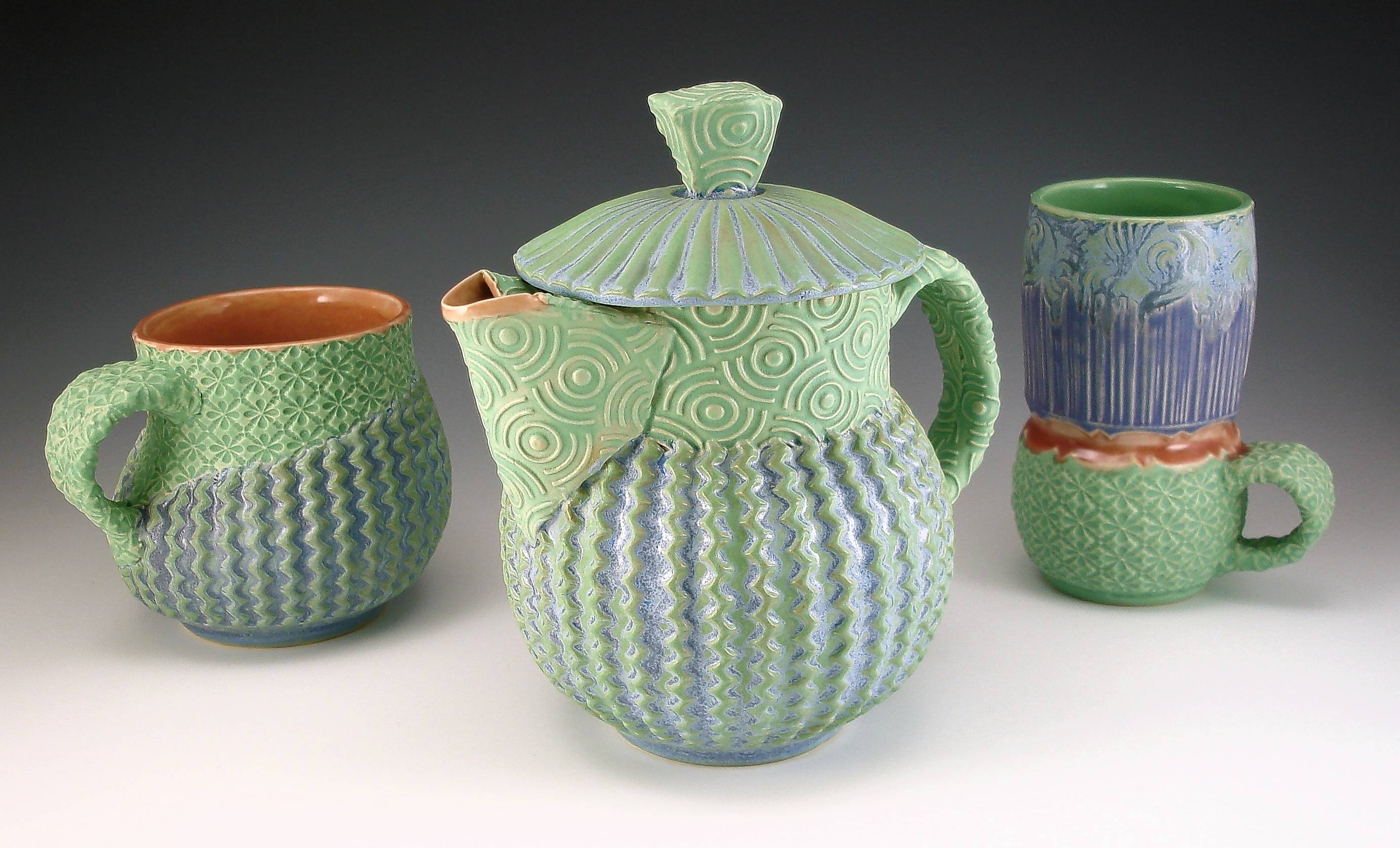 A pitcher and two cups are examples of work by Annie Chrietzburg who will discuss her process at a hands-on pottery workshop Sept. 29-30 at McHenry County College.