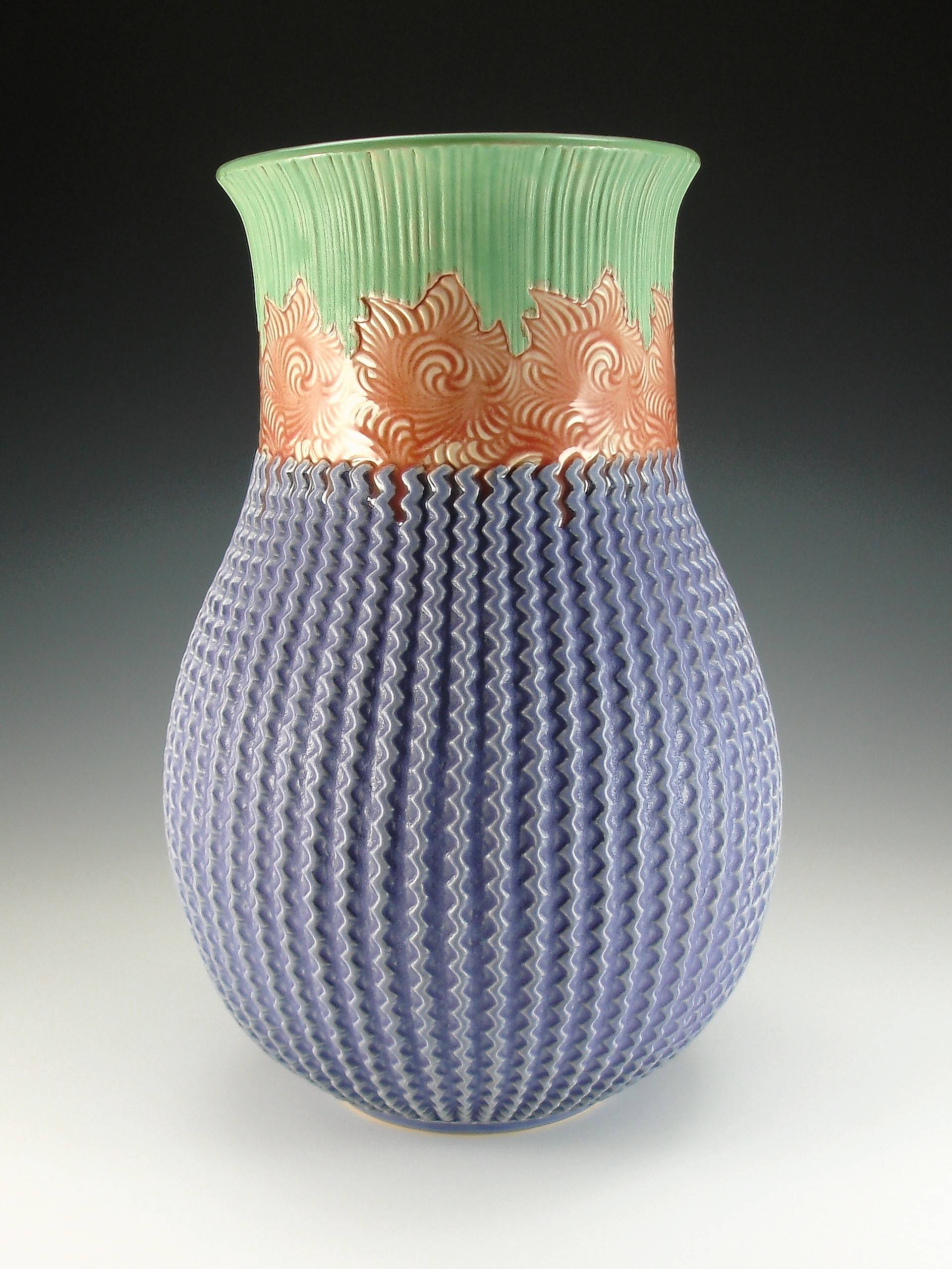 A vase with imprints from Annie Chrietzburg's own templates is an example of her work she will demo at a hands-on pottery workshop Sept. 29-30.