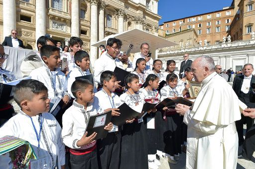 Pope Francis meets members of a children's choir from Mexico during his weekly general audience, in St. Peter's Square, at the Vatican, Wednesday, Sept. 20, 2017. The pontiff prayed for the victims of the 7.1 magnitude quake that hit Mexico on Tuesday leaving several hundred dead, including children trapped under a collapsed school in Mexico City. (L'osservatore Romano/Pool Photo via AP)