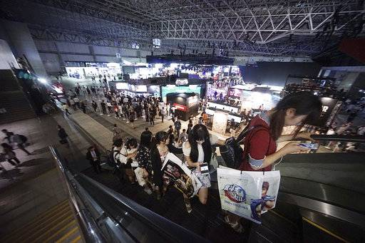 Visitors gather at the annual Tokyo Game Show in Chiba, near Tokyo, Thursday, Sept. 21, 2017. The Japanese video game industry is finding its way out of the doldrums, by adapting new technology for decades-old titles.