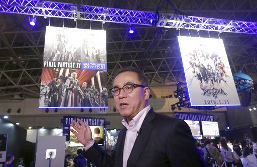 "Square Enix Holdings Co. President Yosuke Matsuda speaks during an interview in front of his company's booth at the Tokyo Game Show in Chiba, near Tokyo, Thursday, Sept. 21, 2017. The Japanese video game industry is finding its way out of the doldrums, by adapting new technology for decades-old titles. That energy was evident at the annual game show. Matsuda said his company is putting out the 15th game of the longtime hit ""Final Fantasy� series."